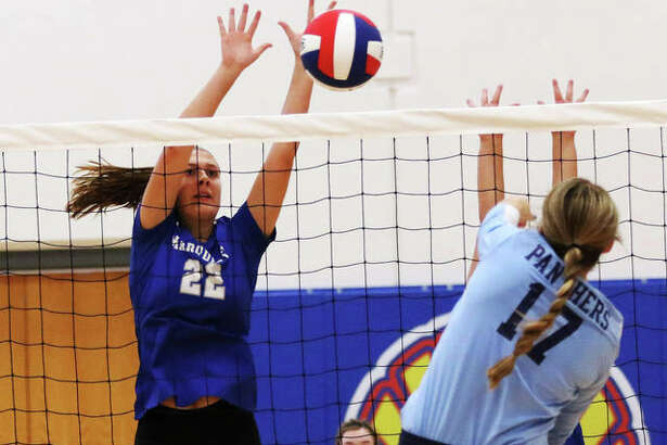 Marquette Catholic middle blocker Natalie Ellebracht (left) gets up for a block of an attack from Jersey's Boston Talley in an Aug. 27 match at the Roxana Tourney. Ellebracht had four kills and three aces in an Explorers win Wednesday night at Madison.
