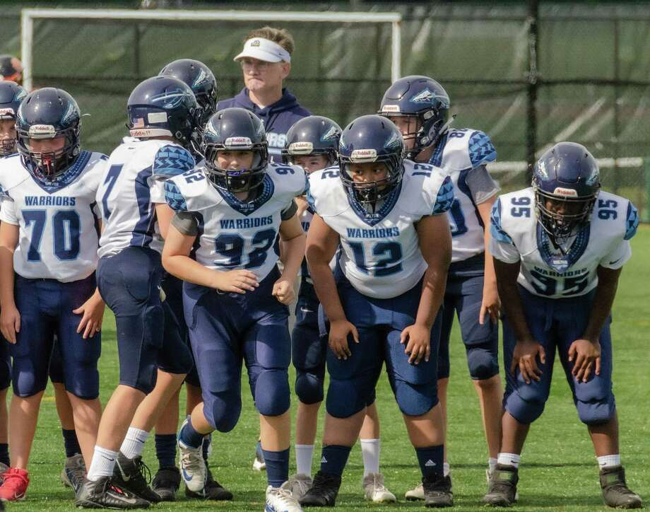 CJ Young (#70), Cael Dexter (#7), Jack Huntley (#92), Jaxon Thomas (#12), Liam McKiernan (#80), and Maja Driscoll (#95) on the field for the Wilton Blue 7th grade team. Photo: Contributed Photo / Wilton Youth Football