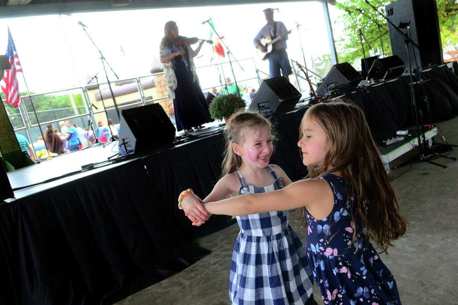Penelope Prue, 5, left, and her friend Aria fiakos, 5, both of Milford, dance together to the music of Ringrose and Freeman during the annual Milford Irish Festival in Milford, Conn. Photo: Christian Abraham / Hearst Connecticut Media / Connecticut Post