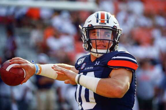 Auburn quarterback Bo Nix (10) warms up before the start of an NCAA college football game between Auburn and Tulane, Saturday, Sept. 7, 2019, in Auburn, Ala. (AP Photo/Butch Dill)