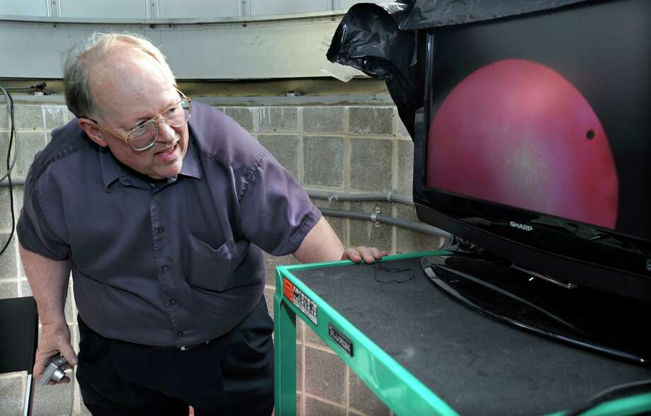 Dennis Dawson, professor of astronomy at Western Connecticut State University, gets a look at the Transit of Venus, televised on a monitor at the observatory on the roof of the Science Building at Western Connecticut State University, Tuesday, June 5, 2012. Photo: Carol Kaliff / Carol Kaliff / The News-Times
