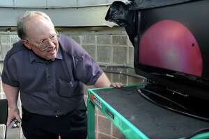 Dennis Dawson, professor of astronomy at Western Connecticut State University, gets a look at the Transit of Venus, televised on a monitor at the observatory on the roof of the Science Building at Western Connecticut State University, Tuesday, June 5, 2012.