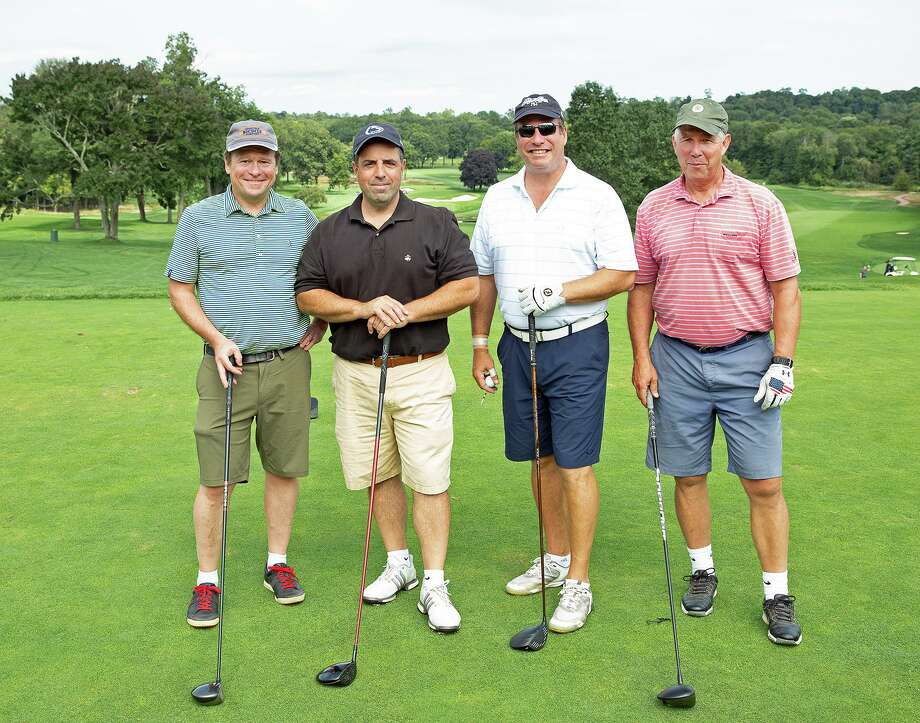 Geoffrey Morris and John Catizone, both of Ridgefield, Michael Diamond of Fairfield and Art Collins of Darien were among the foursomes during The Maritime Aquarium at Norwalk's 9th annual Maritime Golf & Tennis Classic on Sept. 9 at Wee Burn Country Club. More than $170,000 was raised by 114 area business professionals to support the Aquarium's education and conservation efforts. Photo: Maritime Aquarium / Contributed Photo