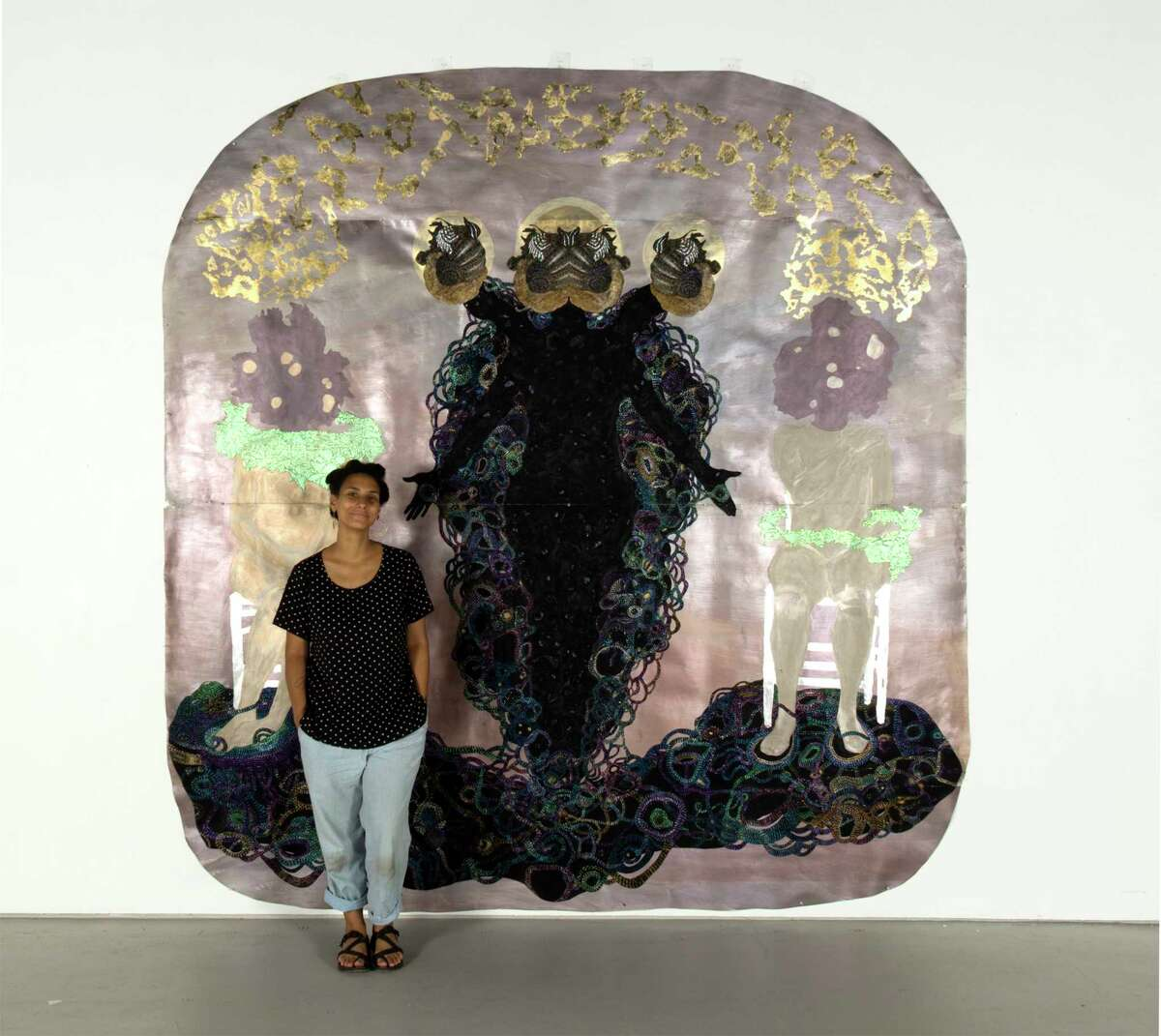 Alisa Sikelianos-Carter with one of her artworks (photo by Jason van Staveren)