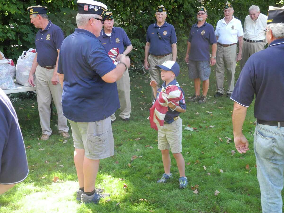 Wilton cub scouts participated in the American Legion Flag Retirement Ceremony last year. Children interested in joining cub scouts may attend an open house with their families on Oct. 17.