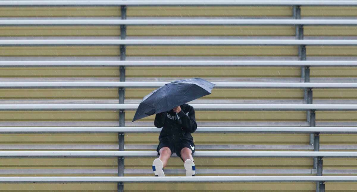 A Montgomery fan sits in the rain before a non-district high school football game, Thursday, Sept. 13, 2018, in Montgomery.