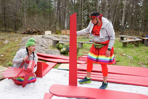 "James Makokis (left) and Anthony Johnson build a massive Muskoka chair in an episode of ""The Amazing Race Canada."""