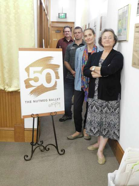 Creators of a museum-quality display marking Nutmeg Ballet's 50th anniversary are, from left: Michael Limoli, Nutmeg audition musician; Craig Winsor, owner of Lines & Letters graphics company; Victoria Mazzarelli, Nutmeg's artistic director; and Denise Warner Limoli, senior ballet mistress at Nutmeg. Photo: Jack Sheedy / Contributed Photo