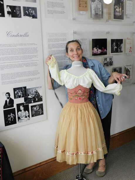 "Victoria Mazzarelli, Nutmeg Ballet's artistic director, clowns around with a costume used in a past production of ""Cinderella,"" part of a history exhibit at the Nutmeg Ballet Conservatory marking the dance organization's 50th anniversary. Photo: Jack Sheedy / Contributed Photo"