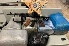 The Webb County Sheriff's Office narcotics unit said they seized the more than 100 pounds of marijuana and assault rifle shown here.