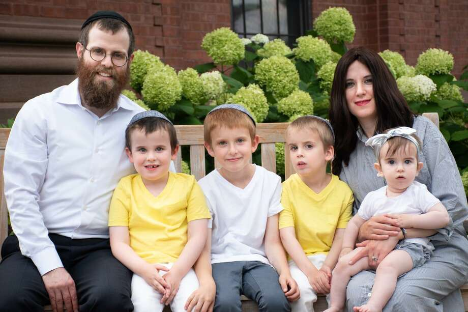 Chabad at Wesleyan will dedicate the new Rohr Center for Jewish Life in Middletown Sunday. Shown here are the directors of the organization, Rabbi Levi, left, and Chanie Schectman, right, and their four children. Photo: Contributed Photo