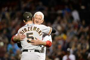 BOSTON, MA - SEPTEMBER 18: Baseball Hall of Famer Carl Yastrzemski hugs his grandson, Mike Yastrzemski #5 of the San Francisco Giants prior to throwing out a ceremonial first pitch for the game between the San Francisco Giants and Boston Red Sox at Fenway Park on September 18, 2019 in Boston, Massachusetts. (Photo by Kathryn Riley/Getty Images)