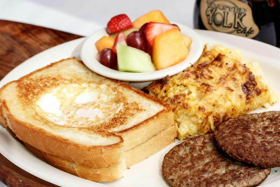 The Toasted Yolk, with two slices of sourdough bread grilled with an egg in the middle of each, is the breakfast and lunch restaurant's signature dish. Photo: The Toasted Yolk
