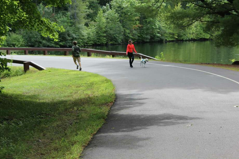 Normal activities resumed at the West Hartford Reservoir trails on Sept. 13,one day after state police investigators were on site with search teams and cadaver-sniffing dogs. Photo: Pat Tomlinson / Hearst Connecticut Media