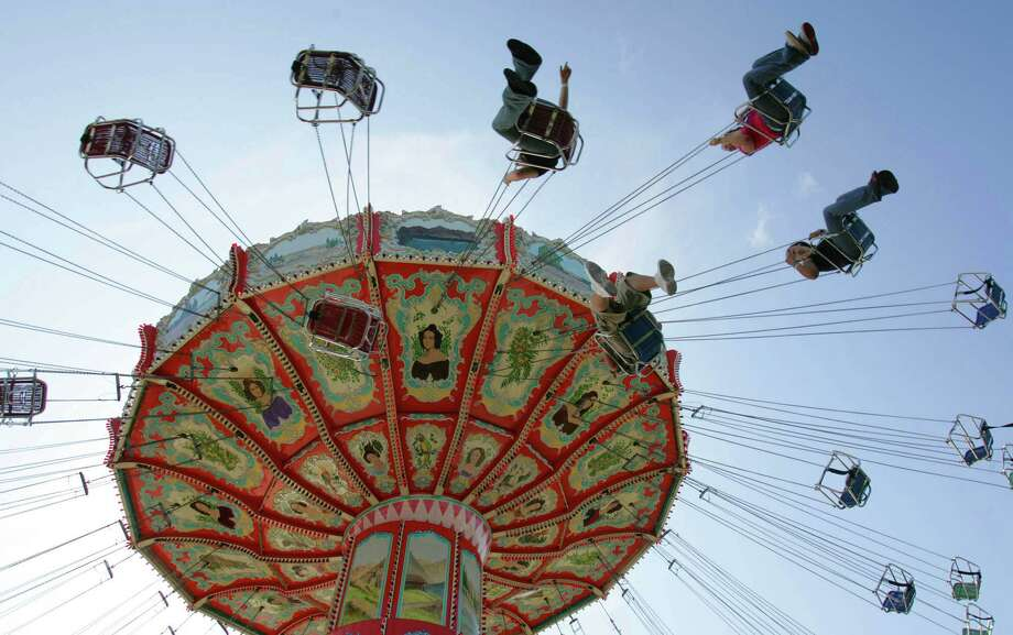 Patrons ride the swings at the Myrtle Beach Pavilion in Myrtle Beach, S.C. Photo: AP / AP
