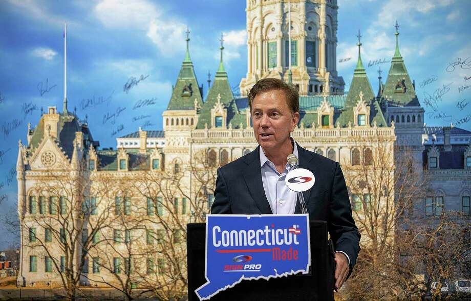 Gov. Ned Lamont speaks in front of an image of The Connecticut State Capitol Sept. 9. The governor announced Tuesday that the prepared food tax hike would be scaled back after legislators of both parties complained about it. Photo: Dave Zajac / Associated Press / Dave Zajac