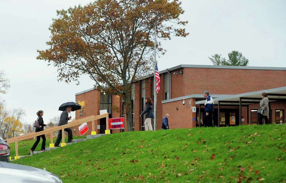 Voters enter and exit at the polling place at Hillcrest Middle School in Trumbull, Conn. on Tuesday Nov. 7, 2017. Photo: Christian Abraham / Hearst Connecticut Media / Connecticut Post
