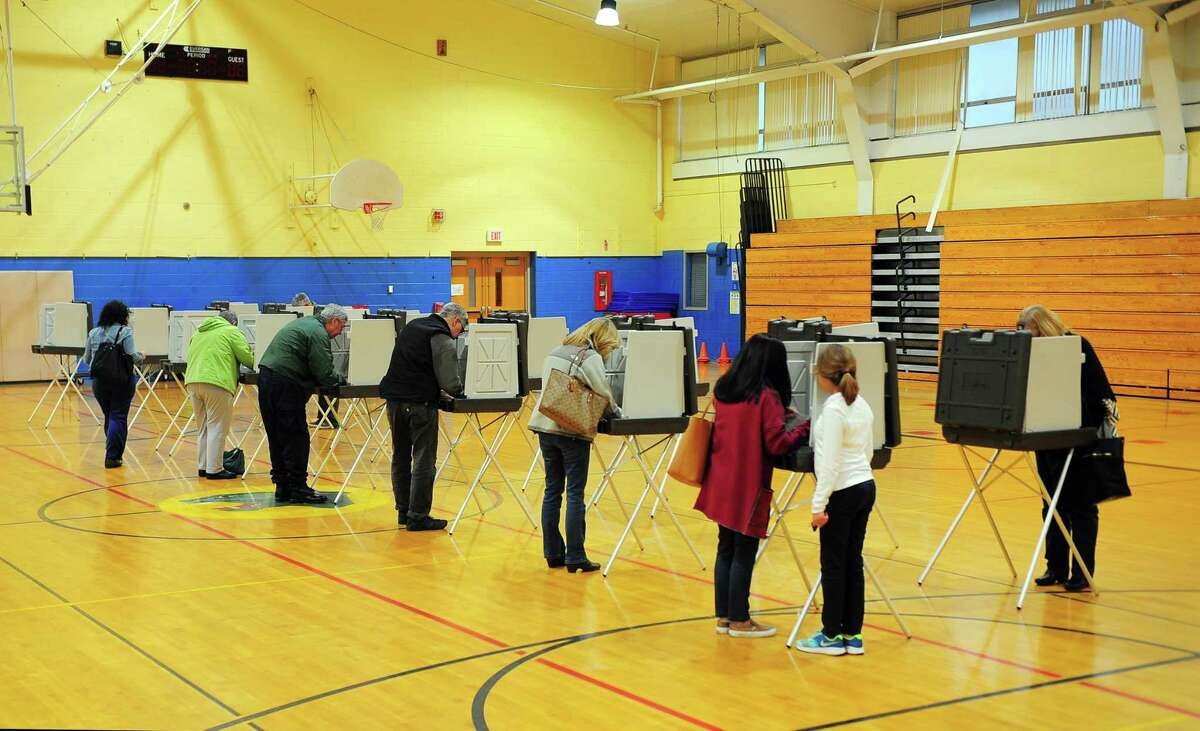 Voters at the polling place at Madison Middle School in Trumbull, Conn. on Tuesday Nov. 7, 2017.