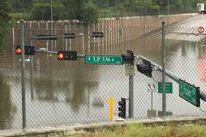 The intersection of South Loop 336 and Frazier Street in Conroe was under water Thursday morning after rains from Tropical Storm Imelda.