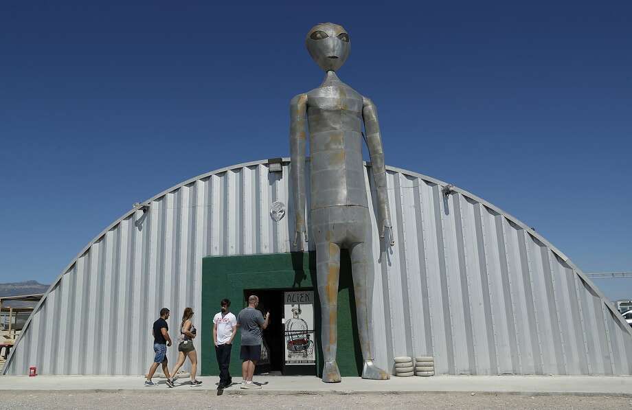 """Visitors check out the Alien Research Center in Hiko, Nev. Many tourists are coming to the area because of an internet joke inviting people to """"see them aliens"""" in nearby """"Area 51."""" Photo: John Locher / Associated Press"""