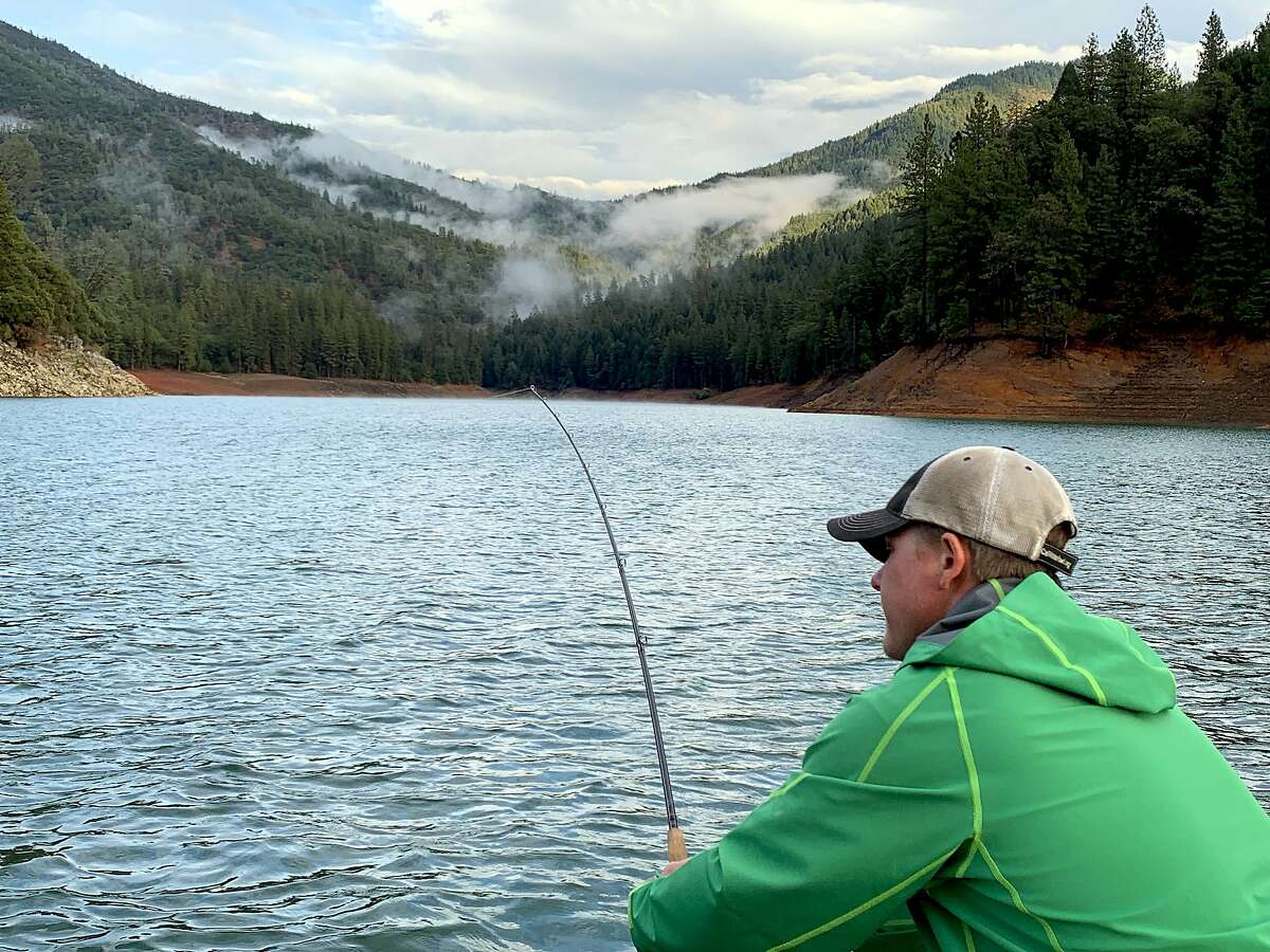 Fish-on at Shasta Lake: Jeremy Keyston grabs the rod during a hook-up
