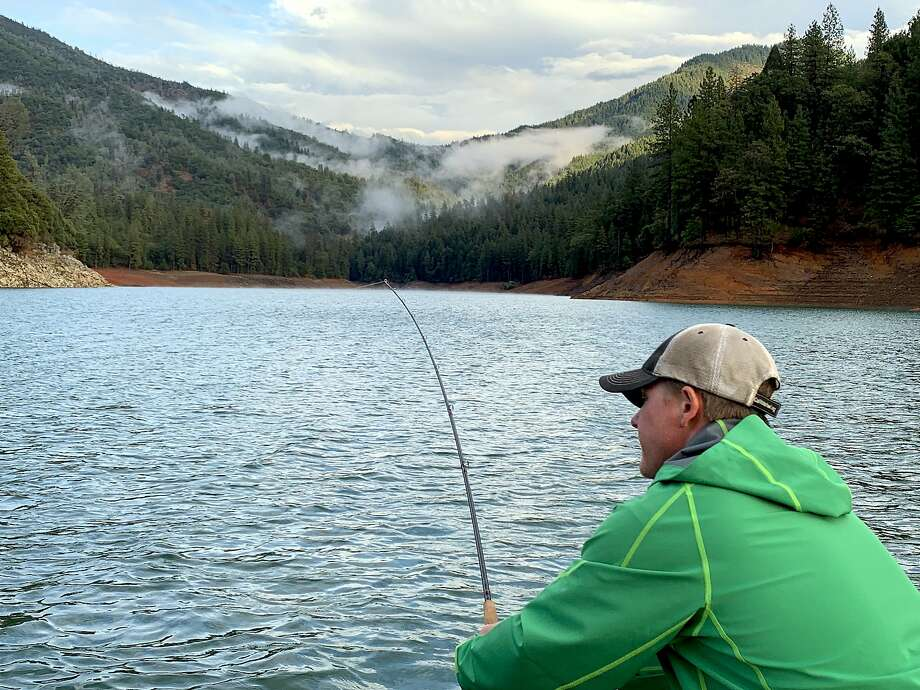 Fish-on at Shasta Lake: Jeremy Keyston grabs the rod during a hook-up Photo: Tom Stienstra, Tom Stienstra / The Chronicle