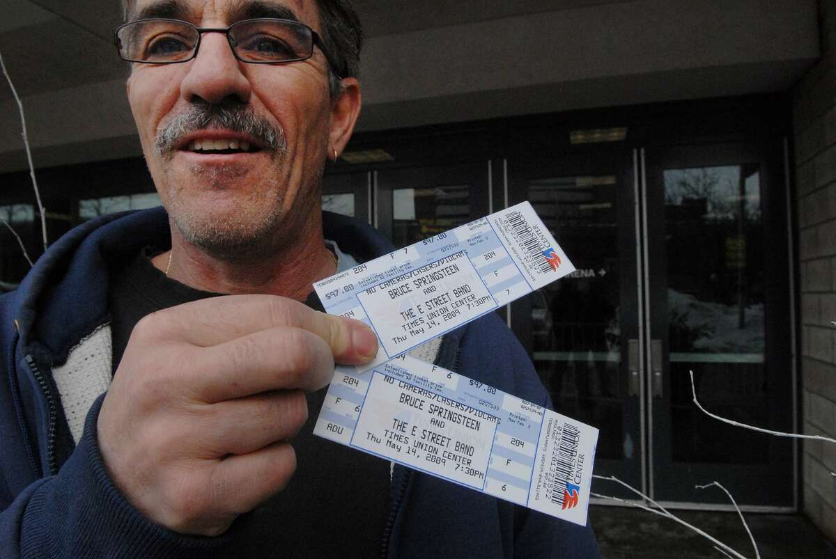 PAUL BUCKOWSKI/TIMES UNION -- Jon McCoy, from Loudonville, NY, shows his Bruce Springsteen tickets he just got at the Times Union Center in Albany, NY on Monday, Feb. 2, 2009. McCoy says he's a huge fan but this will be the first time he sees Springsteen live in concert. The Bruce Springsteen concert will be held in May at the Times Union Center. Tickets went on sale at 10:00 am on Monday.