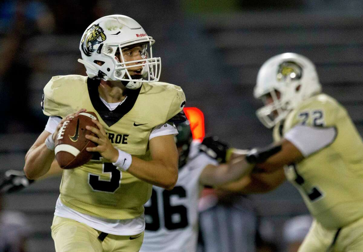 Conroe quarterback Christian Pack (3) looks to pass during the fourth quarter of a non-district high school football game at Buddy Moorhead Stadium, Friday, Aug. 30, 2019, in Conroe.