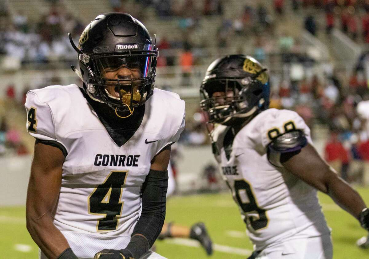 Conroe wide receiver Michael Phoenix (4) celebrates after scoring his third touchdown during a non-district football game Thursday, September 5, 2019 at W.W. Thorne Stadium in Houston.