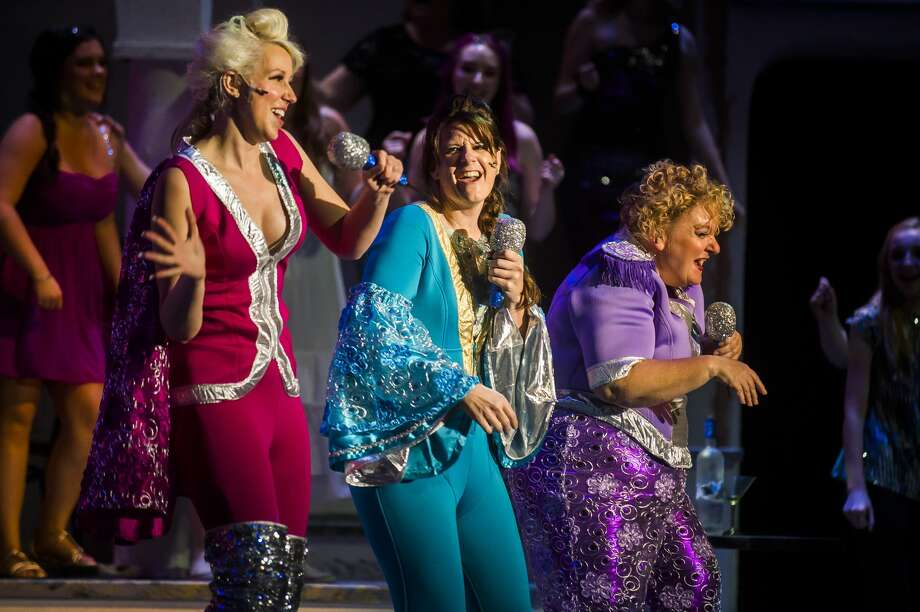 "From left, Natalie Slawnyk in the role of Tanya Cresham-Leigh, Holly Booth in the role of Donna Sheridan and Ann Russell-Lutenske in the role of Rosie Mulligan act out a scene during a dress rehearsal for Great Lakes Bay Regional Alliance's production of ""Mamma Mia!"" Monday, Sept. 16, 2019 at the Midland Center for the Arts. (Katy Kildee/kkildee@mdn.net) Photo: (Katy Kildee/kkildee@mdn.net)"