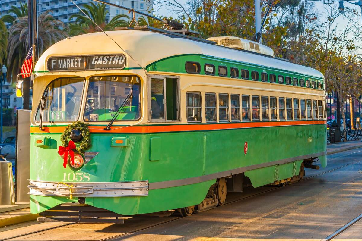 A historic F Market & Wharves streetcar is decorated for Christmas in this Dec. 16, 2013, file photo. Muni is reducing the vintage streetcar service due to an operator shortage.