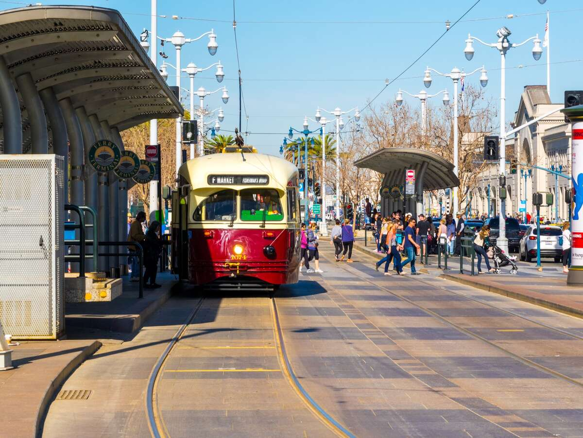 People board a streetcar on F Market & Wharves line in San Francisco in this 2015 photo. Muni is reducing the vintage streetcar service due to an operator shortage