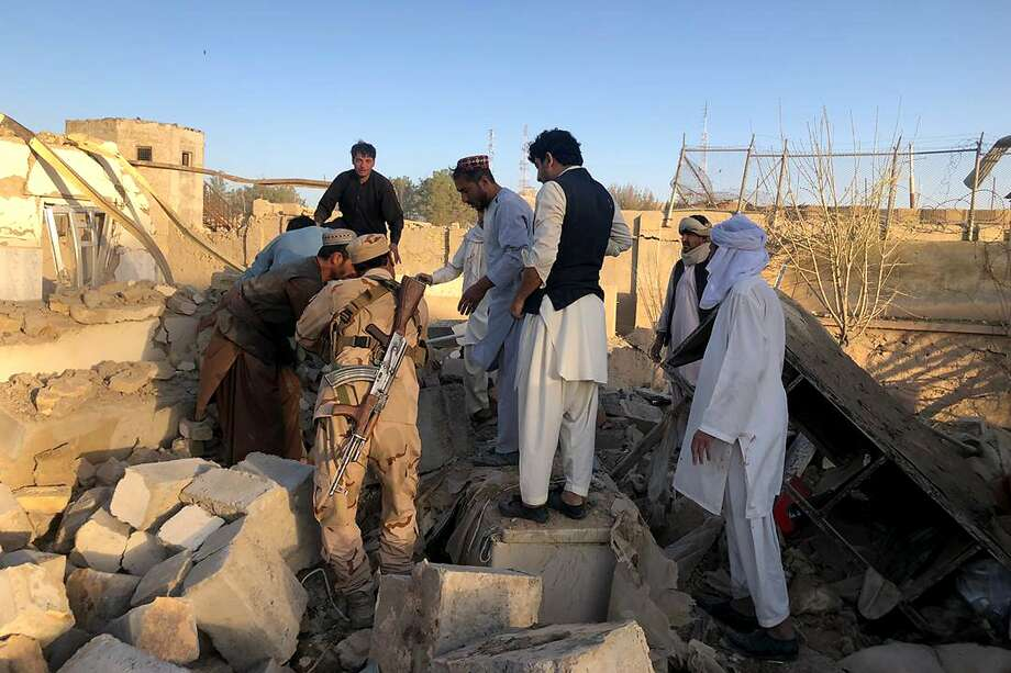 Soldiers and residents inspect the site of a devastated a hospital in Zabul province. The Taliban have carried out nearly daily attacks since peace talks with the U.S. collapsed this month. Photo: Ahmad Wali Sarhadi / Associated Press