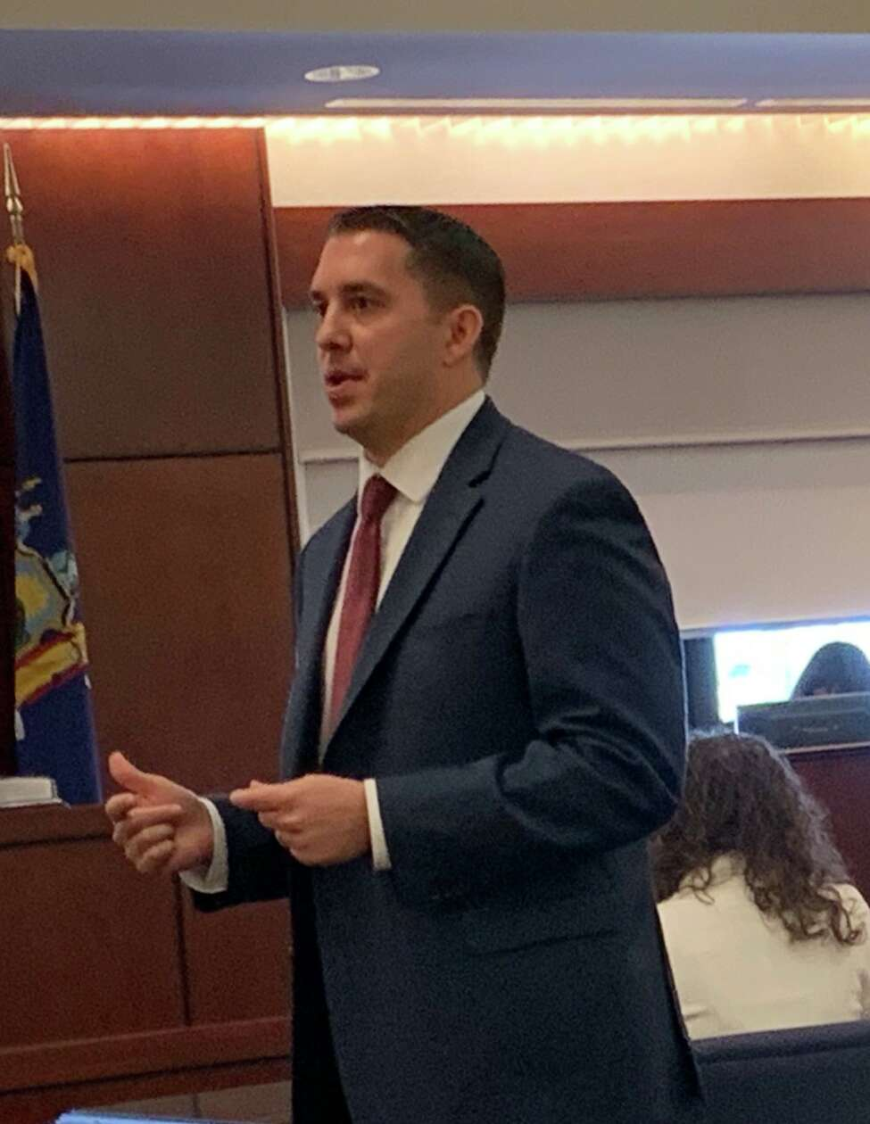Albany County Assistant District Attorney David Szalda speaks to reporters during opening arguments Thursday at the murder trial of Thomas Slivienski, who is accused of killing 17-year-old Johni Dunia last year in Cohoes.