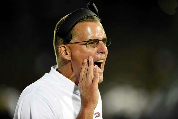 UConn coach Randy Edsall yells to a player on the field during the fourth quarter of an NCAA college football game against Central Florida on Thursday, Aug. 30, 2018, in East Hartford, Conn. UCF won 56-17.