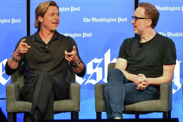 "Brad Pitt and director James Gray, right, during a Washington Post Live event on the new film ""Ad Astra"" on Sept. 16."