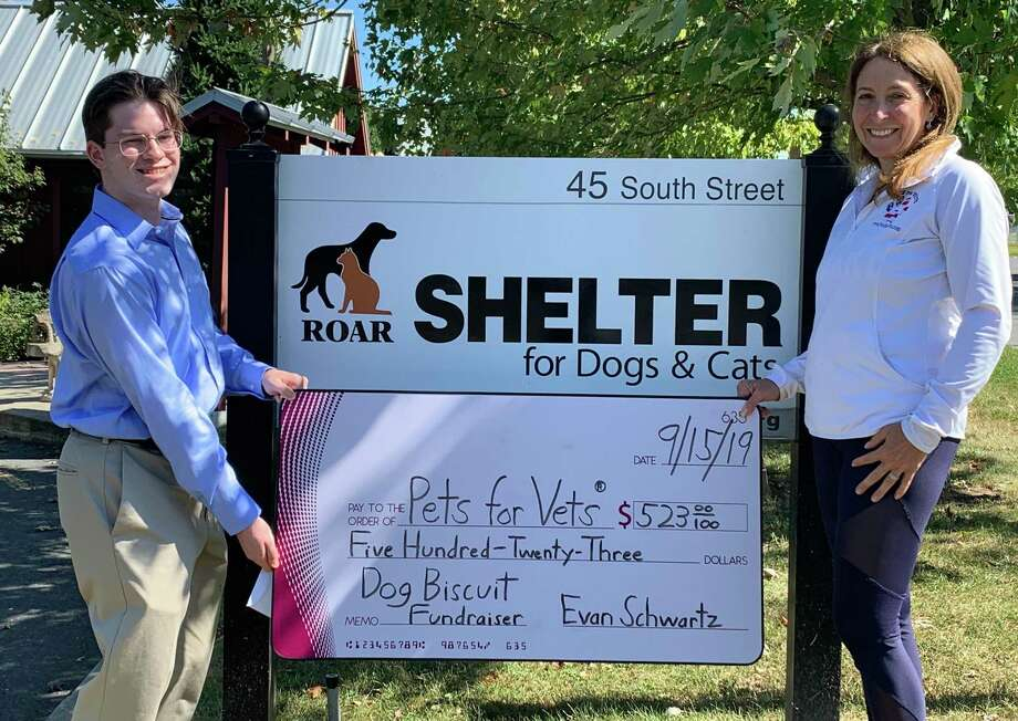 Evan Schwartz and Didi Tulloch, chapter director of Pets for Vets Roar-Ridgefield CT. Photo: Contributed Photo