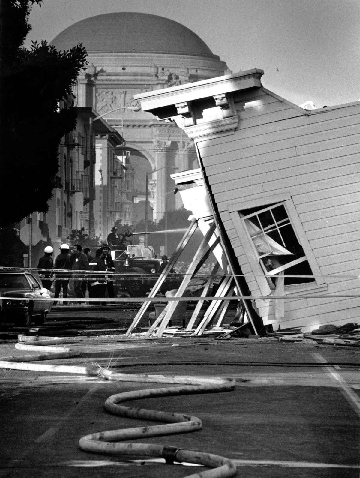 Crews battle a blaze at the Palace of Fine Arts in the background after the Loma Prieta earthquake.