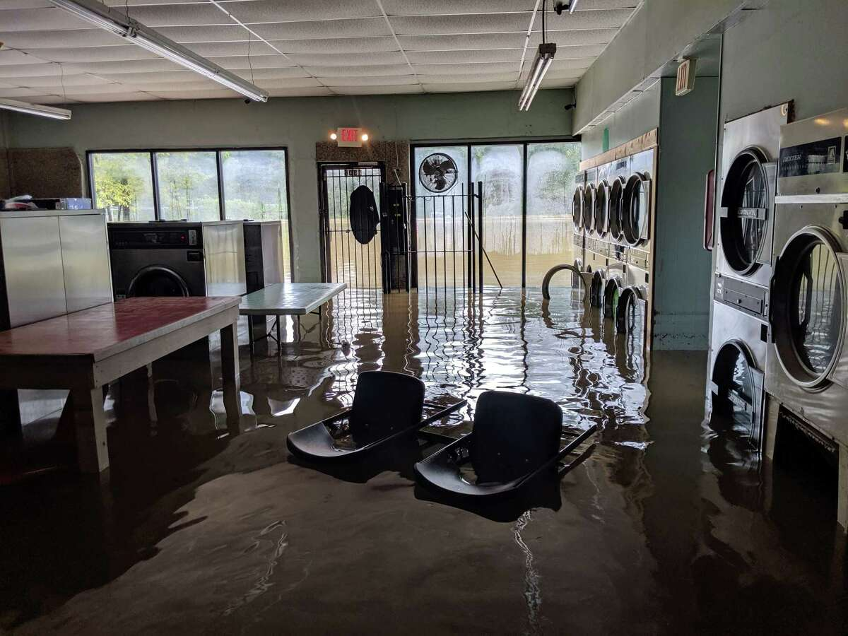 Thursday morning after Tropical Depression Imelda hit Montgomery County, the Wash N Dry on East Davis found itself flooded.