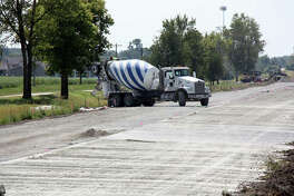 With the southbound lane of Old Troy Road at Glen Crossing Drive paved, Keller Construction crews work on preparations for paving the northbound lane.