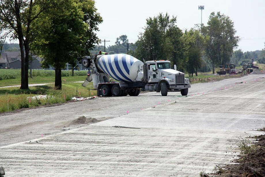 With the southbound lane of Old Troy Road at Glen Crossing Drive paved, Keller Construction crews work on preparations for paving the northbound lane Thursday. Photo: Charles Bolinger | Intelligencer
