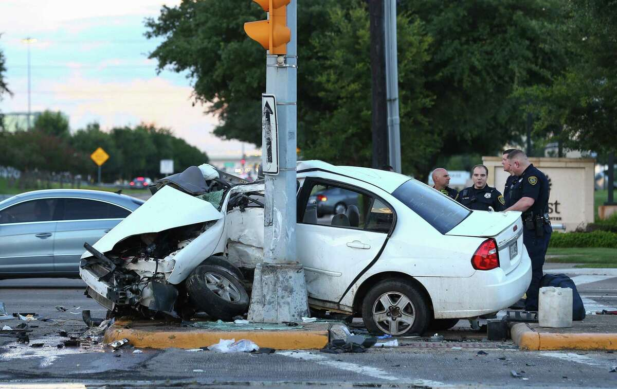 In Houston, home to some of the nation's deadliest roads, there's a high chance you or someone you know will get into a crash. Houston police officers respond to a two-vehicle accident at the intersection of West San Houston Parkway South and Richmond Avenue Tuesday, July 18, 2017, in Houston. ( Godofredo A. Vasquez / Houston Chronicle )