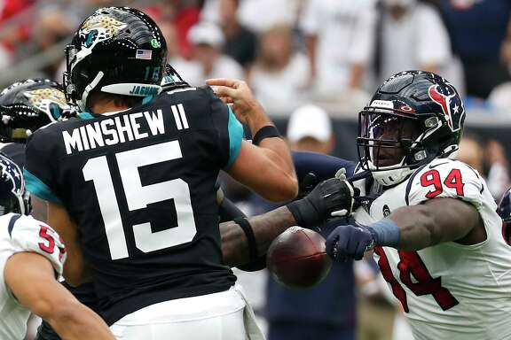 Houston Texans defensive end Charles Omenihu (94) knocks the ball away from Jacksonville Jaguars quarterback Gardner Minshew (15) during an NFL football game at NRG Stadium on Sunday, Sept. 15, 2019, in Houston.