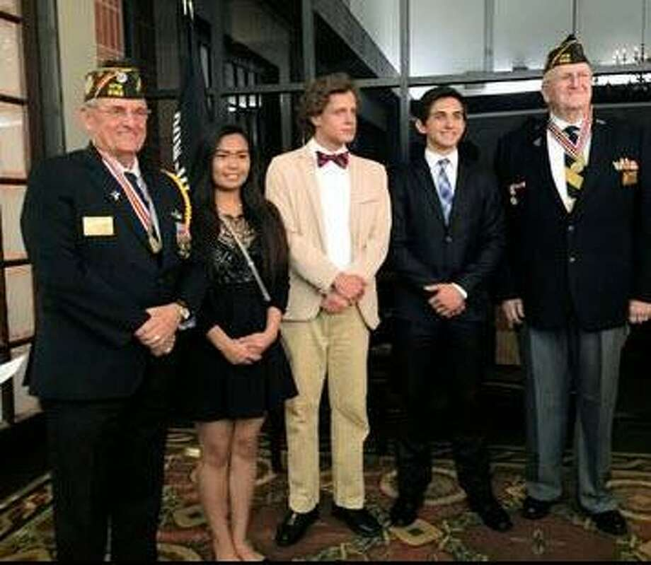 """The Katy Veterans of Foreign Wars 9182 recognized The Voice of Democracy winners in the spring. They are: First Place James Belin Jr. of Tompkins High School, $500 award; Second Place Madison Muldune of Seven Lakes High School, $300 award; Third Place Rowan Lobdell of Tompkins High School, $200 award. This year's theme for the audio-essay program was """"Why My Vote Matters."""" From left are: Tony Hart, senior vice commander; Muldune; Lobdell; Belin and Don Byrne, post commander. Photo: Katy VFW Post 9182 / Katy VFW Post 9182"""