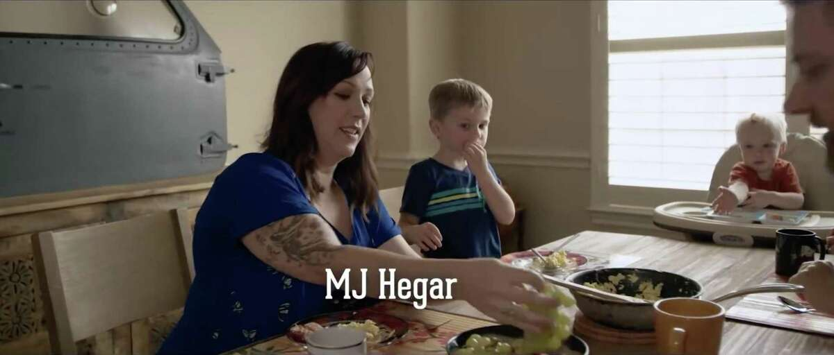 Democrat MJ Hegar's biographic campaign video has more than 5 million views on YouTube and social media. It tells the story of the former Air Force pilot's life, and her military service, including crash-landing a helicopter after it was shot down in Afghanistan. She was honored with the Purple Heart and the Distinguished Flying Cross. In this still image taken from the video, Hegar has breakfast with her two sons. In the background is a door from the helicopter that she crash-landed. She is running for Congress against 8-term incumbent Rep. John Carter of Round Roc
