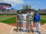 From left, Theo Epstein, Mark Loretta, and Joe Maddon, right, pose with Bruce Bochy (15) of the San Francisco Giants before a game against the Chicago Cubs in celebrating Bochy's upcoming retirement, at Wrigley Field in Chicago on Thursday, Aug. 22. (Quinn Harris/Getty Images/TNS) **FOR USE WITH THIS STORY ONLY**