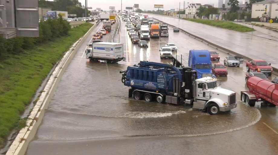 Vehicles are stranded by high water on the Katy Freeway at Patterson after Tropical Depression Imelda soaked the Houston area on Thursday, Sept. 19, 2019. Photo: Jay R. Jordan/Houston Chronicle