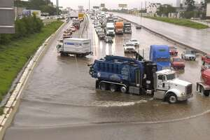 Vehicles are stranded by high water on the Katy Freeway at Patterson after Tropical Depression Imelda soaked the Houston area on Thursday, Sept. 19, 2019.