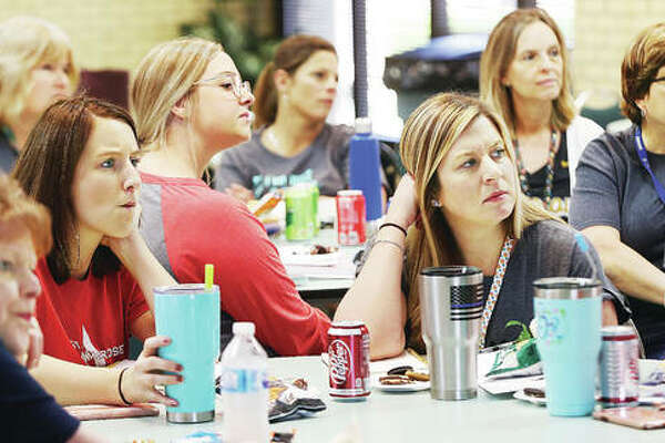 Early Childhood Program teachers at St. Ambrose School in Godfrey had some serious faces this week as they watched a video of how a teacher in Mexico handled her classroom during a shooting spree between two cartels outside the school. The teacher managed to get the kids into safer locations and positions without scaring them. That was the theme of an active shooter education program conducted for the teachers by the Institute for Child Preparedness.