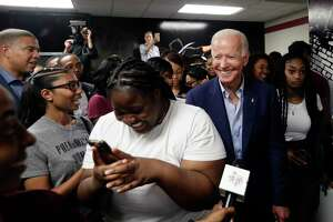 Presidential candidate Joe Biden visits with students on the campus of Texas Southern University on Sept. 13, the day after the Democrats held a debate in Houston where immigration was an issue.